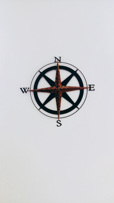 old fashioned compass rose on a plain wall